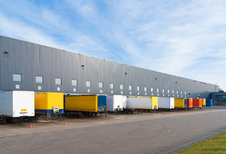 Photo for Large commercial warehouse with trailers in front - Royalty Free Image