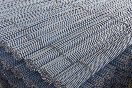 Foto de Steel Bars, Construction Material for Concrete, Stacked in a Plant Store - Imagen libre de derechos