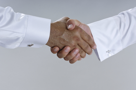 Saudi Arab Businessmen Hands Shaking, Making Agreement and Welcoming Closeup