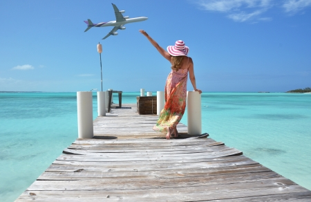 Photo pour Girl on the wooden jetty  Exuma, Bahamas - image libre de droit