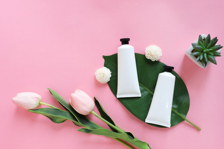 Foto für Flat lay of beauty skincare products for mock up in minimal style with plant and flower on pink background - Lizenzfreies Bild