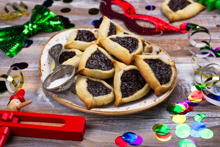 Foto de Traditional Jewish Hamantaschen cookies with berry jam. Purim celebration concept - Imagen libre de derechos