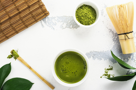 Photo for Green matcha tea drink and tea accessories on white background - Royalty Free Image