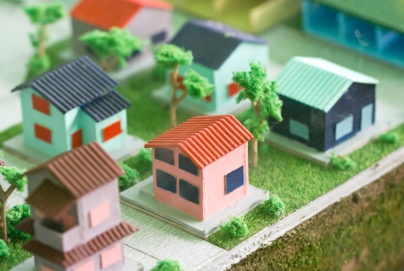 Photo for Model home on grass. - Royalty Free Image
