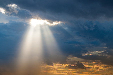 Photo for sun ray light through down from rain cloud during sunset time - Royalty Free Image