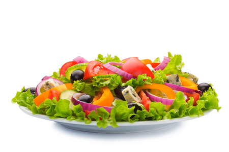 Photo pour Greek salad in plate isolated on white background - image libre de droit