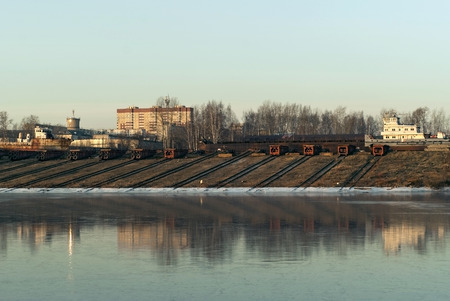 Photo for  slipways with roller-pallets of ship repair yard for river vessels on the shore of the winter canal   - Royalty Free Image