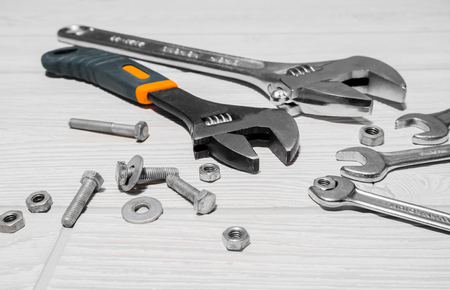 Photo pour Adjustable spanners and ordinary wrenches, nuts and bolts are on the table close up - image libre de droit