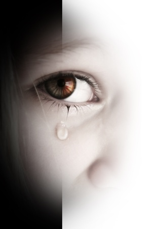 Little sad girl with tears in her eyes
