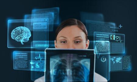 Foto de Female medicine doctor working with modern computer interface as concept - Imagen libre de derechos
