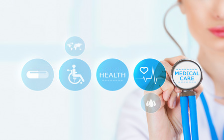 Photo for Medicine doctor hand holding stethoscope and working with modern medical icons - Royalty Free Image