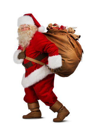Foto de Santa Claus on the run to delivery christmas gifts isolated on white background - Imagen libre de derechos