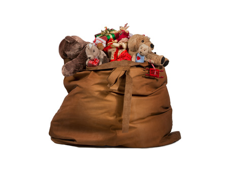Foto de Santa Claus gift bag full of toys and gifts isolated over white background - Imagen libre de derechos