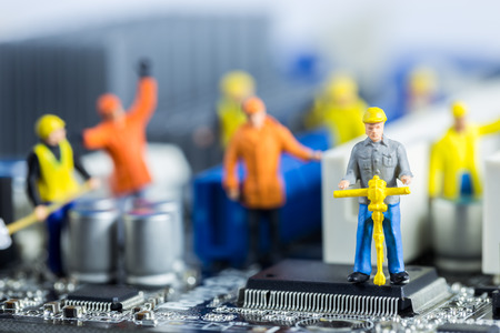 Foto de Team of engineers repairing circuit mother board. Computer repair concept - Imagen libre de derechos