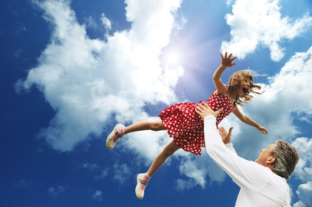 Photo for Father and daughter against sky  - Royalty Free Image