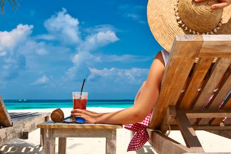 Foto de Woman at beautiful beach with chaise-lounges - Imagen libre de derechos