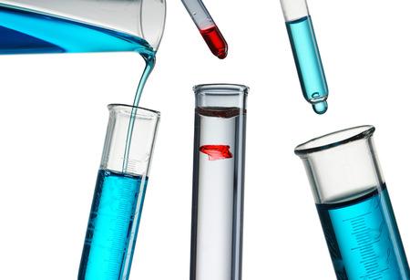 Foto de Pouring reagent into test tube - Imagen libre de derechos