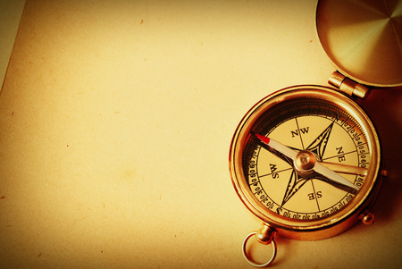 Photo for Antique brass compass over old map background - Royalty Free Image