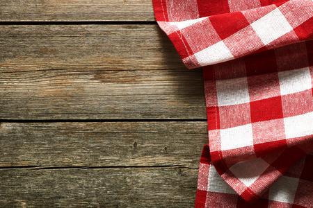 Foto de Red tablecloth on rustic background - Imagen libre de derechos