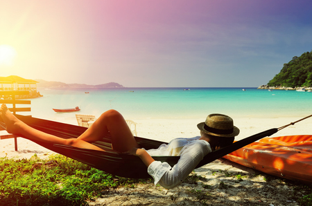 Foto de Woman in hammock on tropical beach at Perhentian islands, Malaysia - Imagen libre de derechos