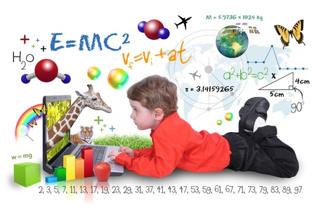 Photo pour A young boy child is looking at a laptop computer with math, science and animals around him  He is on a white background  Use it for a school, study or learning concept   - image libre de droit