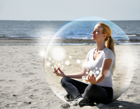 Photo for A woman is sitting on the beach inside a bubble with peace and tranquility  She is meditating and there are sparkles   - Royalty Free Image