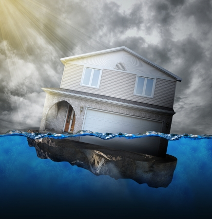 Photo pour A house is sinking in water for a mortgage debt or natural disaster concept. - image libre de droit