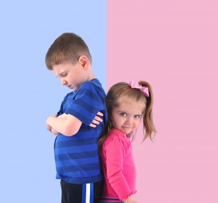 Foto de Two children are standing on a pink and blue divided background upset and unhappy for a discipline or gender concept. - Imagen libre de derechos