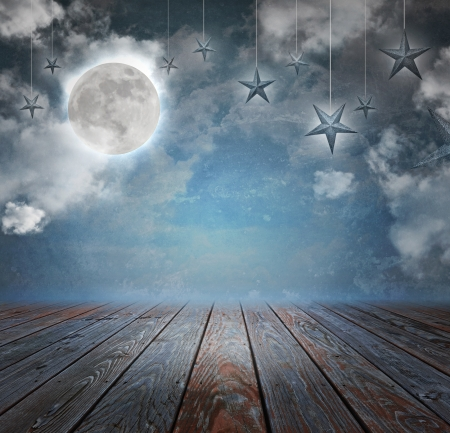 Foto de A moon and stars are in the night sky with wood on the bottom copyspace area to add your text message. - Imagen libre de derechos