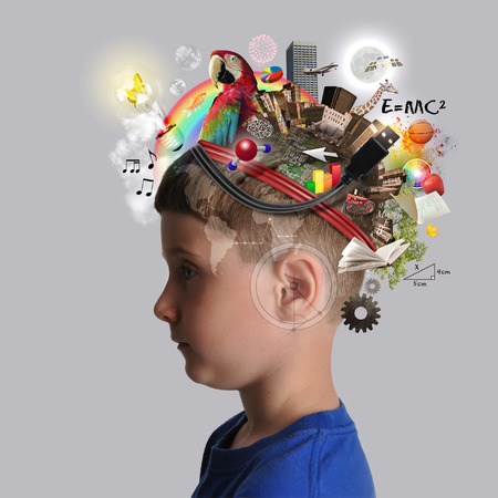 Foto de A child has various education and school objects on his head with a isolated background. Subjects are art, science, technology and nature. - Imagen libre de derechos