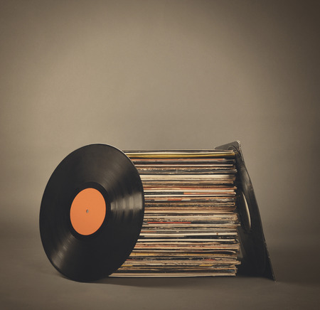 Photo pour A stack of old retro vinyl records on an isolated gray background for a party or entertainment concept. - image libre de droit