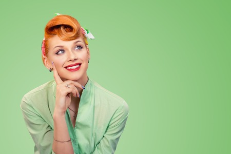 Photo pour Closeup portrait of charming, smiling joyful, happy, young woman looking upwards daydreaming something nice, thinking isolated on green background. Positive human emotions, facial expressions feelings - image libre de droit