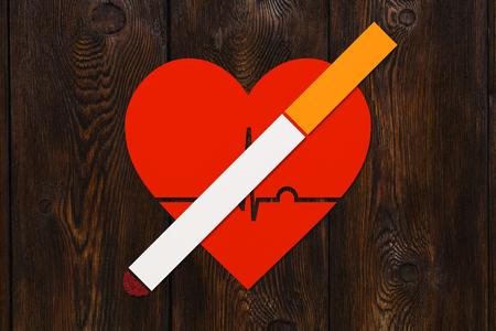 Foto de Cigarette and heart with echocardiogram. Health or quit smoking concept. Abstract conceptual image - Imagen libre de derechos