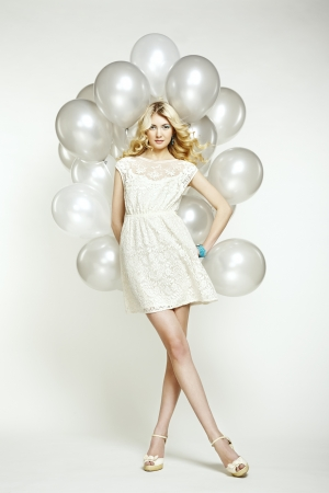 Foto de Fashion photo of beautiful woman with balloons. Girl posing. Studio photo - Imagen libre de derechos