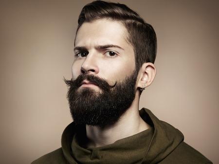 Foto de Portrait of handsome man with beard  Close-up - Imagen libre de derechos