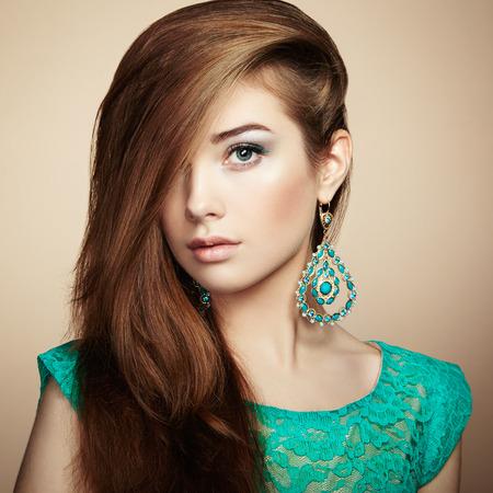 Photo pour Portrait of beautiful young woman with earring - image libre de droit
