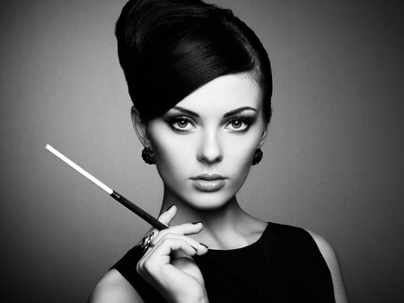 Photo for Portrait of beautiful sensual woman with elegant hairstyle.  Woman with cigarette Perfect makeup. Fashion photo. Black and white photo - Royalty Free Image