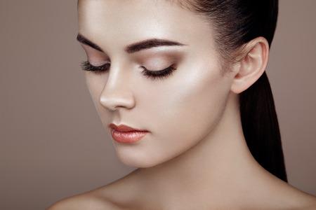 Photo for Beautiful woman face. Perfect makeup. Beauty fashion. Eyelashes. Cosmetic Eyeshadow. Highlighting - Royalty Free Image