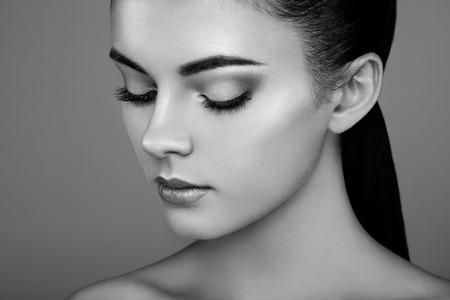 Foto de Beautiful woman face. Perfect makeup. Beauty fashion. Eyelashes. Cosmetic Eyeshadow. Highlighting. Black and white - Imagen libre de derechos