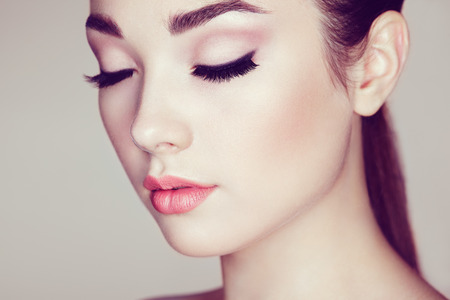 Photo for Beautiful woman face. Perfect makeup. Beauty fashion. Eyelashes. Lips. Cosmetic Eyeshadow - Royalty Free Image