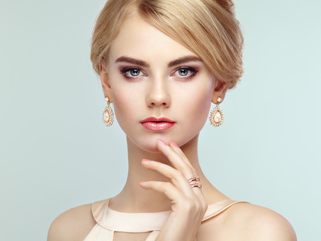 Photo pour Portrait of beautiful sensual woman with elegant hairstyle.  Perfect makeup. Blonde girl. Fashion photo. Jewelry and dress - image libre de droit