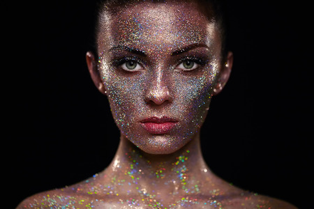 Photo for Portrait of beautiful woman with sparkles on her face. Girl with art make up in color light. Fashion model with colorful make-up - Royalty Free Image