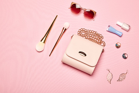 Photo for Fashion lady accessories set. Falt Lay. Stylish handbag. Make-Up brushes. Summer sunglasses. Jewelry and nail polish. Women accessories. Trendy fashion design - Royalty Free Image