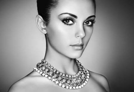 Photo for Portrait of young beautiful woman with perfect makeup. Face Girl with necklace close up. Fashion jewelry. Black and White photo - Royalty Free Image