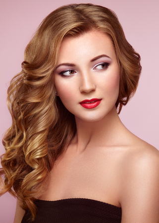 Photo for Blonde woman with long and volume shiny wavy hair . Beautiful model with curly hairstyle. - Royalty Free Image