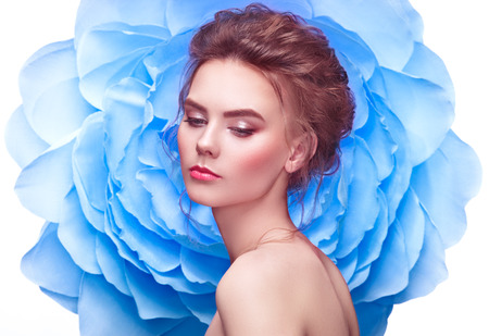 Photo for Beautiful Woman on the Background of a Large Flower. Beauty Summer Model Girl with Blue Peony. Young Woman with elegant Hairstyle and Makeup. Fashion Photo - Royalty Free Image