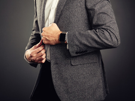 Photo for Handsome Young Man in Business Suit. Casual Style and Electronic Gadgets. Smart Watch, Business style - Royalty Free Image