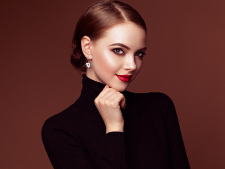 Photo pour Beautiful Young Woman with Clean Fresh Skin. Perfect Makeup. Beauty Fashion. Red Lips. Cosmetic Eyeshadow. Smooth Hair. Girl in Black Turtleneck - image libre de droit