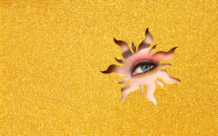 Photo pour The Eyes of the Young Beautiful Woman with Bright Pink Shadows and Expressive Eyebrows, Looks in the Solar Shaped Pattern out of Yellow Paper. Yellow Sun. Summer Patterns. Advertising Banner - image libre de droit