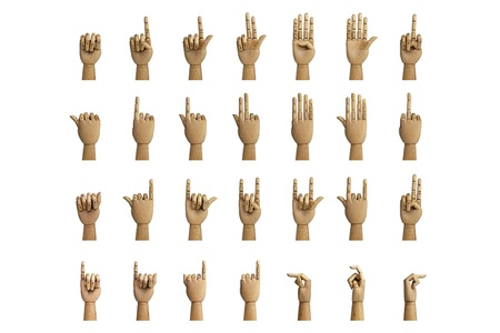 Hand signals through an artificial hand made of wood, isolated on a white background